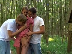Two dudes start banging a horny golden-haired's twat hole outdoors